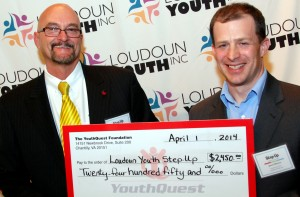 YouthQuest Foundation Co-Founder and Vice President Allen Cage presents a check to Loudoun Youth President and CEO Jared Melvin at the 2014 Step Up Loudoun Youth competition.