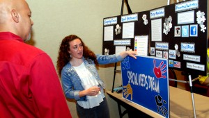 Madeline O'Neill explains her winning project to judge Cory Laws at the 2014 Step Up Loudoun Youth Competition