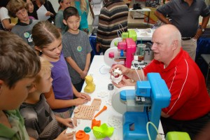 YouthQuest Director of Instruction Tom Meeks talks to children about 3D printing at a STEM career fair in Dulles, Va.
