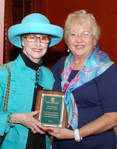 YouthQuest Co-Founder and President Lynda Mann presents Chris Eaton's Volunteer of the Year Award to his mother, Betty Eaton