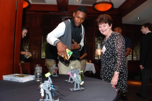 3D ThinkLink Lab student Daikwon Jones explains his solar robot to Joy Gilstrap at YouthQuest's VIP Reception Aug. 7, 2014