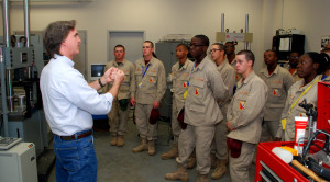 Dr. David Rocheleau leads a tour of a mechanical engineering lab at the University of South Carolina during vocational orientation for YouthQuest's 3D ThinkLink students from the South Carolina Youth ChalleNGe Academy Oct. 23, 2014.