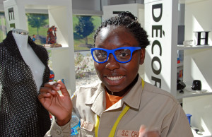 Sherquana Adams tries on 3D-printed eyeglasses during a visit to 3D Systems headquarters in Rock Hill, SC.