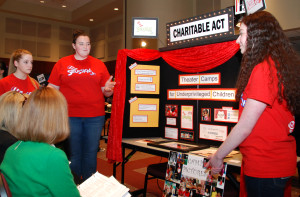 Allison Ball, Kelsey Clark and Hannah Ratcliffe explain their project, Charitable Act, at the 2015 Step Up Loudoun Youth Competition