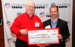 YouthQuest Director of Instruction Tom Meeks presents prize money for the 2015 Step Up Competition to Loudoun Youth President Jared Melivin