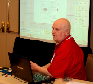 YouthQuest Director of Instruction Tom Meeks shows students how to use Moment of Inspiration 3D design software in a workshop at the NSBE convention in Anaheim, California, March 26, 2015.
