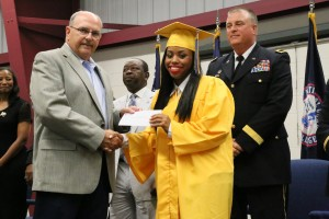 Cadet Aaliyah Lilly receives her essay contest scholarship from YouthQuest Secretary Bill Hall at SCYCA graduation June 10.