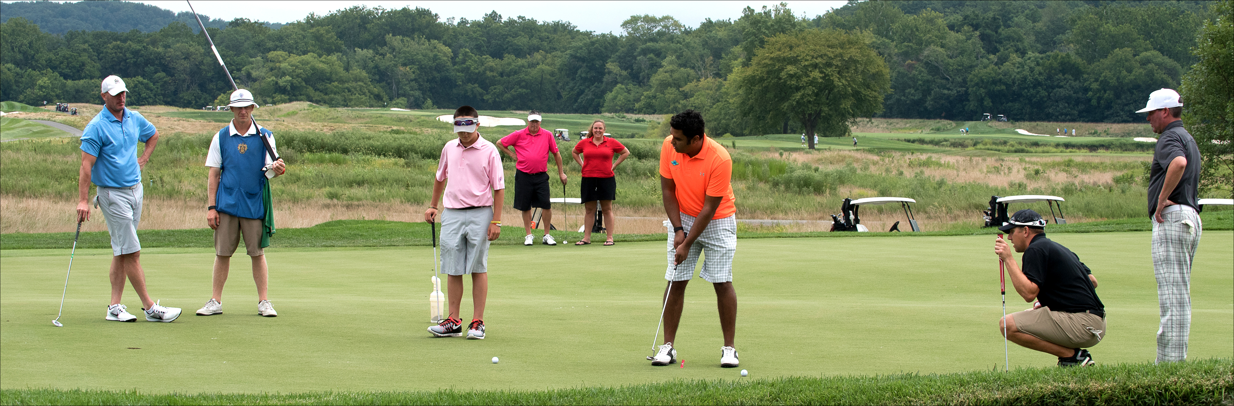 Golfers at YouthQuest's 10th Annual Challenge at Trump National Golf Club August 10, 2015