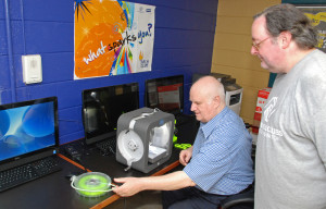 Tom Meeks (left) and Chris Roberts set up equipment for 3D ThinkLink classes at Culmore Club