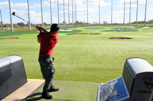A Capital Guardian ChalleNGe Academy Cadet hits a drive at Topgolf Loudoun during 3D ThinkLink class Vocational Orientation