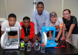 Advanced students with Cube 2 printers during immersion week in the 3D ThinkLink Lab