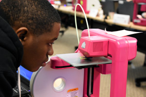 Capital Guardian Youth ChalleNGe Academy graduate Amadou Abakar watches his 3D design take shape on a Cube 2 printer during January 2016 immersion week in YouthQuest's 3D ThinkLink Creativity Lab