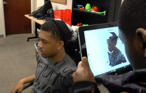 Amadou Abakar scans Nate Sydnor while the Capital Guardian Youth ChalleNGe Academy graduates evaluate 3D scanners during January 2016 immersion week in YouthQuest's 3D ThinkLink Creativity Lab
