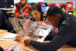 South Carolina Youth ChalleNGe Academy graduate Emilee Bray and and Freestate ChalleNGe Academy graduate Osman Bah build a JellyBox 3D printer during January 2016 immersion week in YouthQuest's 3D ThinkLink Creativity Lab