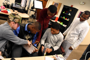 Justin Lewis, John Smith, Osman Bah, Nate Sydnor and Josh Nembhard compare 3D scanner features during January 2016 immersion week in YouthQuest's 3D ThinkLink Creativity Lab