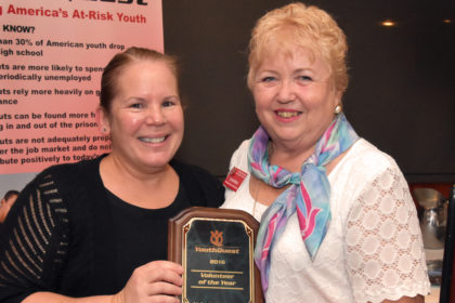 Co-Founder and President Lynda Mann presents YouthQuest's 2016 Volunteer of the Year Award to AOC's Valerie Hightower in August 4