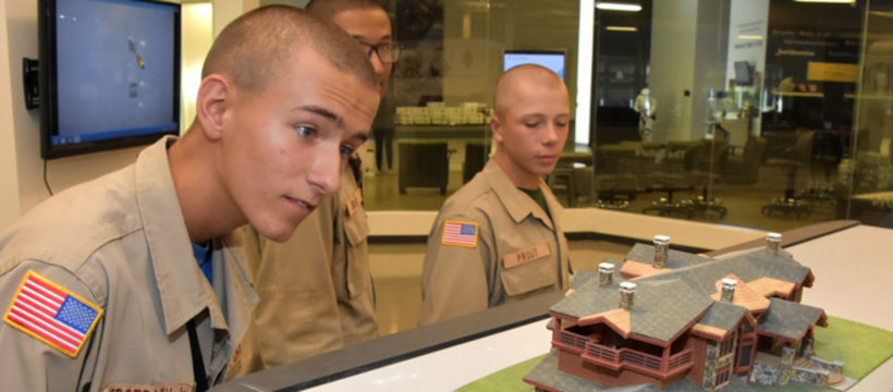 Students look at a 3D printed architectural model at 3D Systems in Rock Hill, SC, during 3D ThinkLink Vocational Orientation October 20, 2016