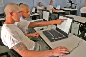 3D ThinkLink students using laptop computers in class