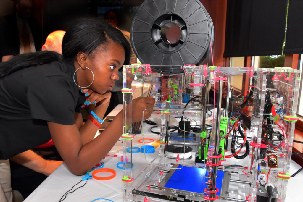 Capital Guardian Youth ChalleNGe Academy graduate NeLazjay Brown operates a 3D printer she assembled during advanced training in YouthQuest's 3D ThinkLink Creativity Lab on August 4, 2016, in Chantilly, Virginia.