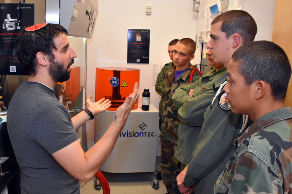 Graduate student Max Lerman shows 3D ThinkLink students from Freestate and Capital Guardian Youth ChalleNGe Academies the 3D printers he uses in the University of Maryland's Tissue Engineering and Biomaterials Lab. The students visited the lab for Vocational Orientation on October 13, 2016.