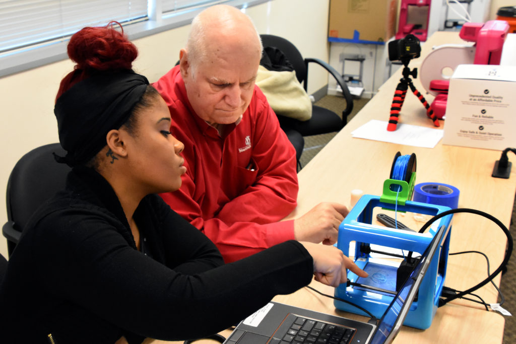 Freestate ChalleNGe Academy graduate Aunya' Jones and YouthQuest Director of Instruction Tom Meeks work on setting up a 3D printer during Youth Mentor training in the 3D ThinkLink Creativity Lab on January 11, 2017 in Chantilly, Virginia.