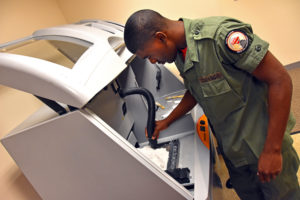 Capital Guardian Youth ChalleNGe Academy Cadet LaMarcus Corley uses the lab's full-color powder printer for the first time during immersion training week in YouthQuest's 3D ThinkLink Creativity Lab June 2017