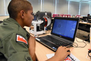 Capital Guardian Youth ChalleNGe Academy Cadet Adrian Vasquez uses Moment of Inspiration 3D software to create a design during immersion training week in YouthQuest's 3D ThinkLink Creativity Lab June 2017