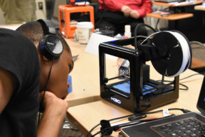 Freestate ChalleNGe Academy Cadet Stephen Brown checks a print on an M3D Micro 3D printer during immersion training week in YouthQuest's 3D ThinkLink Creativity Lab June 2017