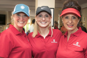 Volunteer of the Year Tammy Haug (center) with volunteers Erica Stewart and Carol Schick from AOC at YouthQuest's 2017 charity golf tournament