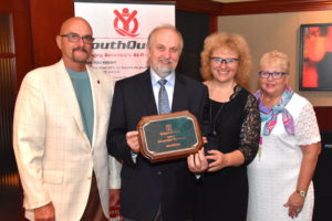 IMADE3D owners Ladi Goc and his wife, Ivana Gocova, accept our 2017 Strategic Partner Award from YouthQuest Co-Founders Allen Cage and Lynda Mann at the foundation's annual VIP Reception on August 3.