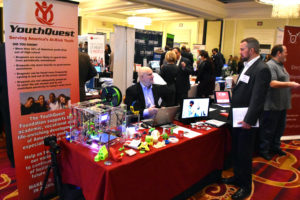 YouthQuest Director of Instruction Tom Meeks at the foundation's display at the Greater Washington Innovation Awards Showcase in March 2017