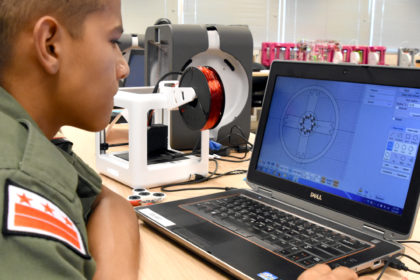 Adrian Vasquez works on a 3D design in YouthQuest's 3D ThinkLink Creativity Lab